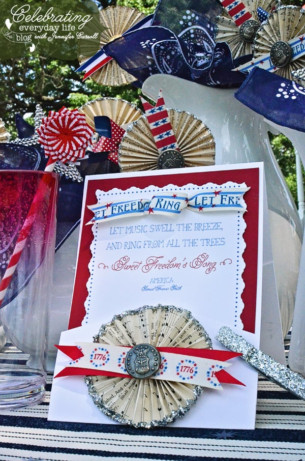 Paper medallions with vintage military buttons, patriotic ribbons & vintage sheet music with bandanas and white pitchers