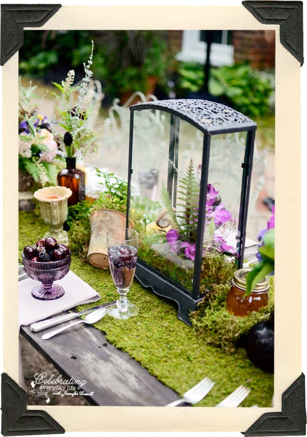 Blackberries and Cherries in Champagne, Lilac Champagne, Honey jar centerpiece, brown bottle centerpiece, brown bottle centerpiece, moss covered table, moss centerpiece, wildflower centerpiece, storybook table, fairy tale table, fern centerpiece, fern flower arrangement, mushrooms and ferns in lanterns