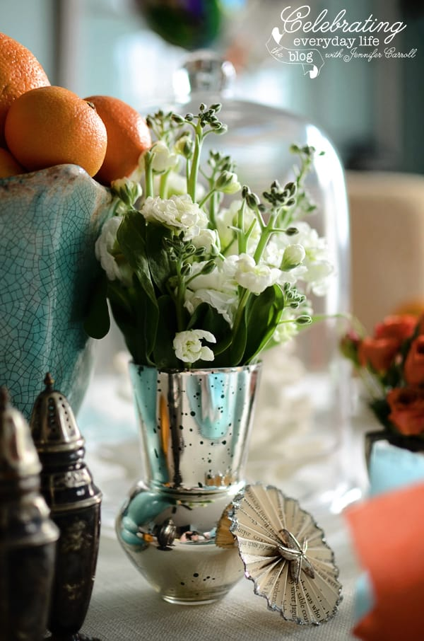Mercury glass vase filled with white stock 