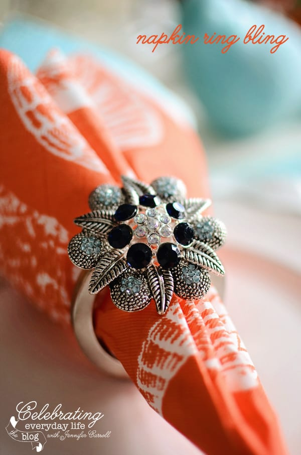 orange shell napkin from Caspari with a DIY bejeweled napkin ring