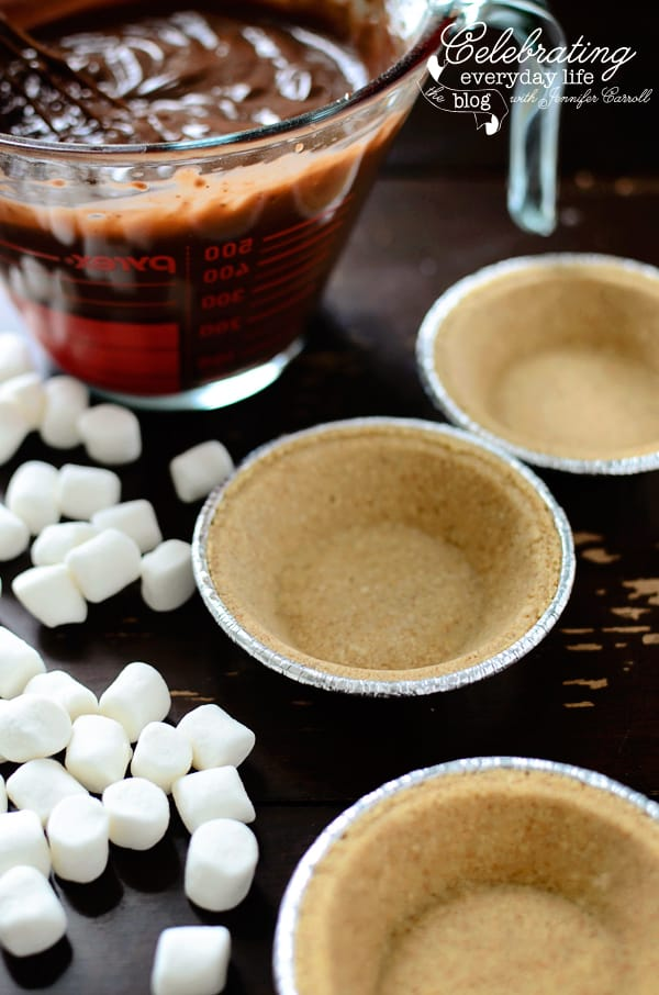 Ingredients for mini s'more pies, mini graham cracker crusts, mini marshmallows, chocolate pudding