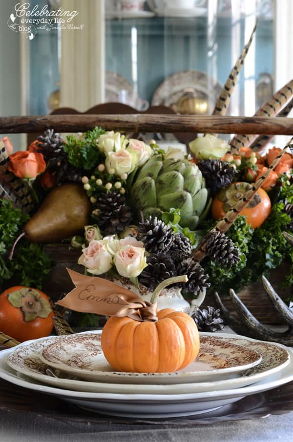 How to make your own Thanksgiving Centerpiece, pheasant feathers, fruit & vegetable centerpiece ideas, artichoke centerpiece, mini pumpkin with ribbon place card