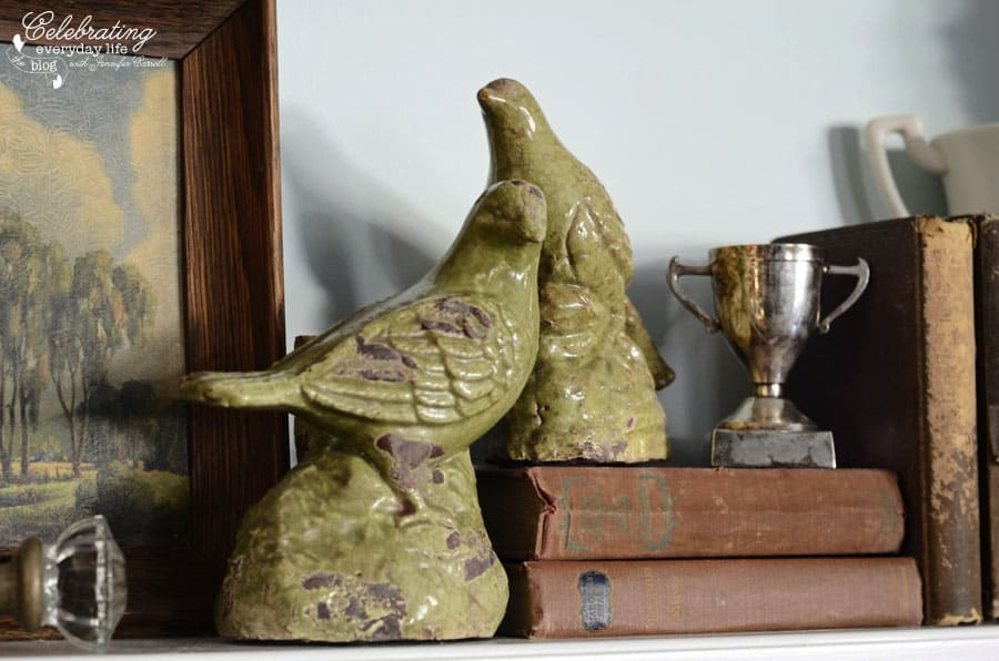 green bird statues