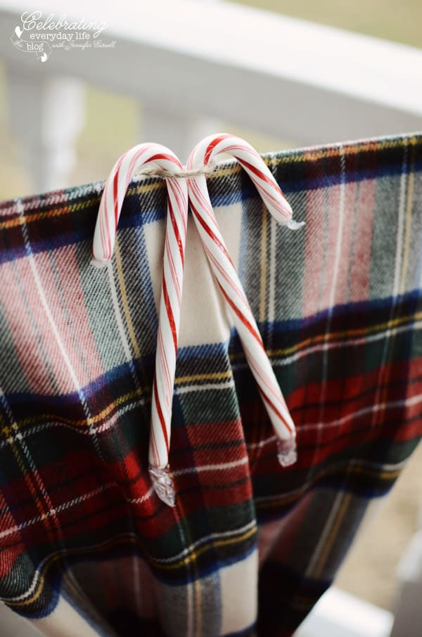 Candy Canes with plaid scarf on red steel chair
