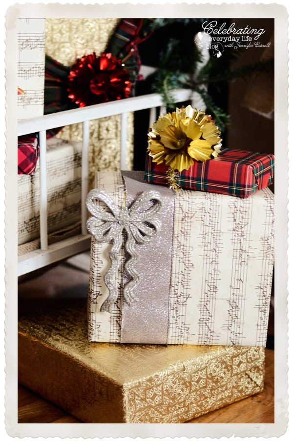 Sheet music wrapped gift, glitter bow ornament, plaid gift wrap from Caspari