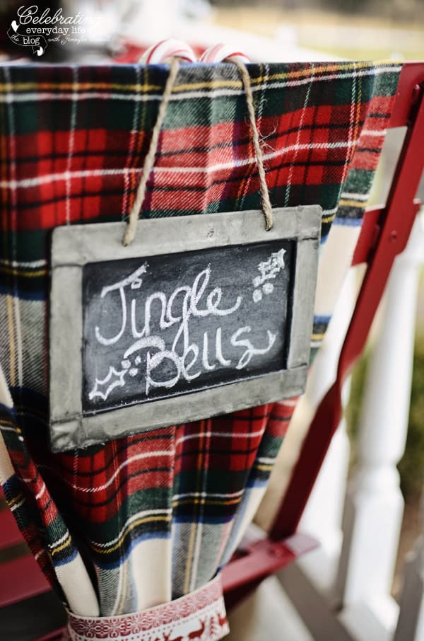 Jingle Bells chalk sign, plaid scarf chair decor, hot cocoa front porch party