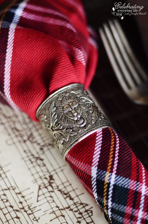 silver lion's head Napkin Ring with plaid napkin