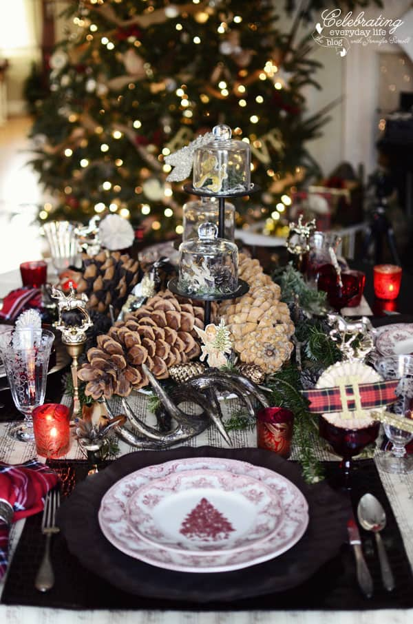 Christmas Placesetting with red transferware, pinecones, red plaid, red votives