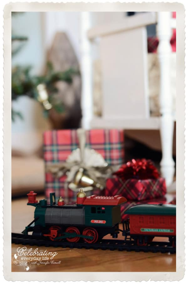 Christmas train with Christmas gifts in the background