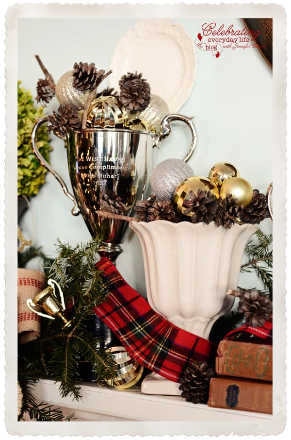 Silver trophy with plaid ribbon, silver trophy with pinecones and ornaments