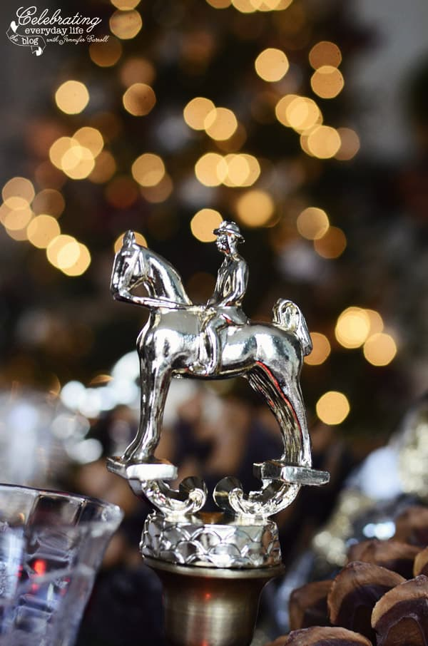 horse Trophy with Christmas tree lights in background