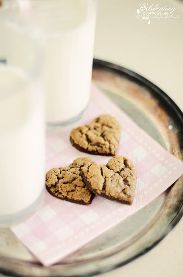 Gingerbread Heart cookies on pink and white check napkin and vintage silver tray