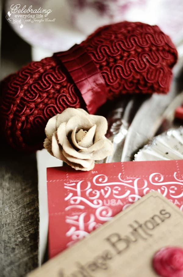 Rose Pencil, red trim and red ribbon