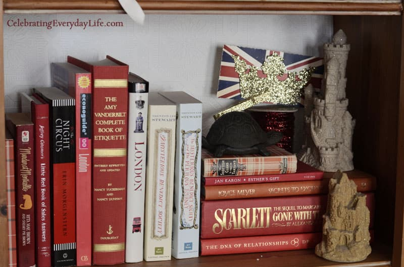 Book Shelf decor, styling book shelves, decorating bookshelves, red books, decorating with red books