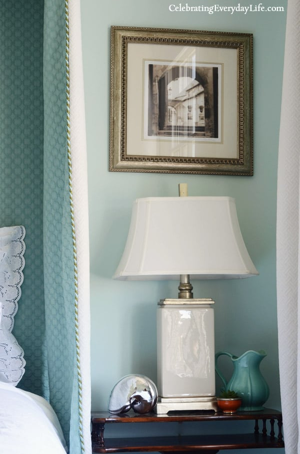 Lamp on Nightstand, turquoise pitcher, silver nautilus shell