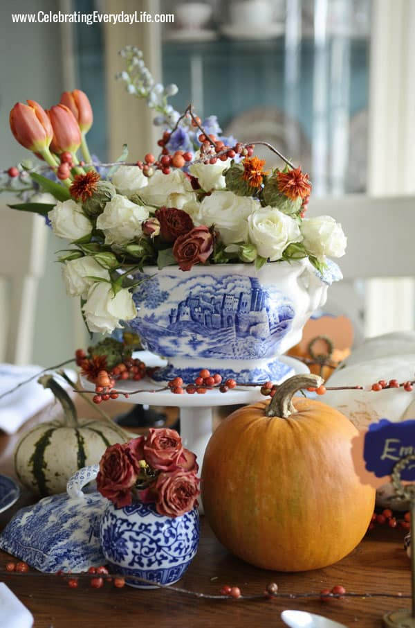 Orange tulips, white garden roses, orange garden roses, Delphinium, Safflower, faux bittersweet, A Blue Willow Thanksgiving Tablescape, Blue and White Thanksgiving Table, Blue and White place setting, Blue, White and Orange Thanksgiving Table, Celebrating Everyday Life with Jennifer Carroll