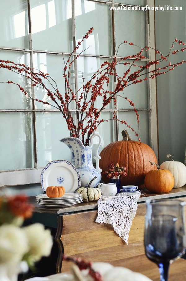 Buffet with bittersweet, pumpkins, blue & white china, A Blue Willow Thanksgiving Tablescape, Blue and White Thanksgiving Table, Blue and White place setting, Blue, White and Orange Thanksgiving Table, Celebrating Everyday Life with Jennifer Carroll