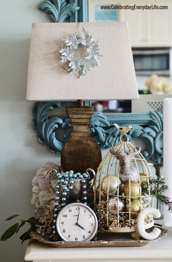 Lamp with wreath ornament, vintage clock, birdcage with ornaments, Celebrating Everyday Life with Jennifer Carroll
