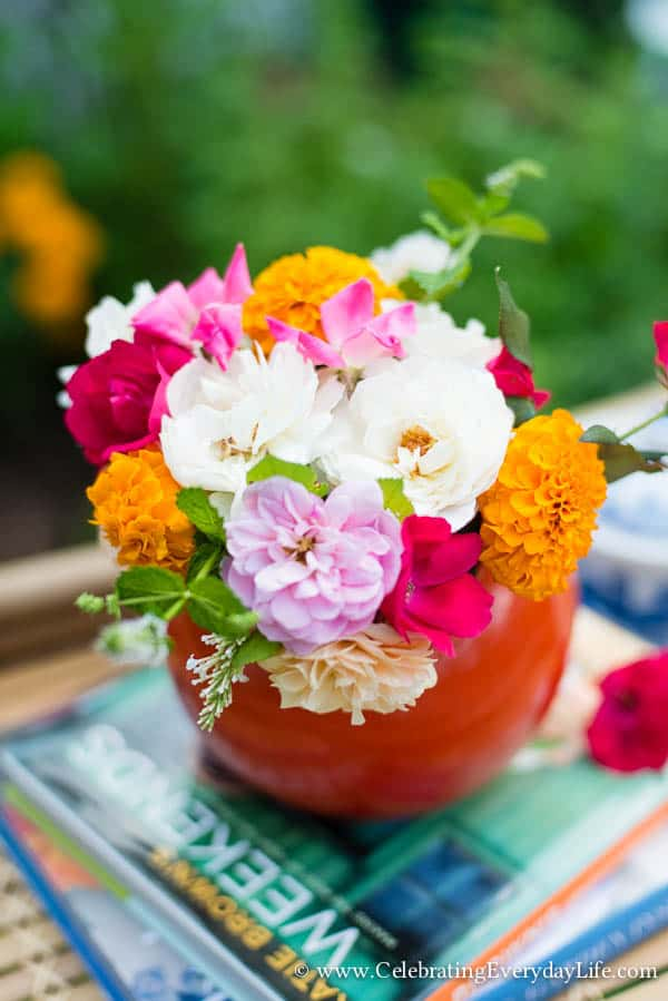 A summer floral arrangement, summer flowers, summer garden florals, garden roses in a pitcher, citrus flowers, orange and pink flower arrangement, Celebrating Everyday Life with Jennifer Carroll