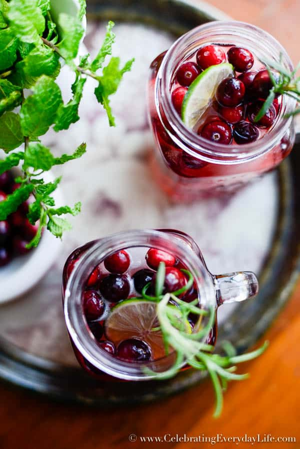 Cranberry Green Tea Spritzer recipe, Christmas cocktail, christmas mocktail, Christmas punch recipe, Christmas drink recipe, Rosemary cranberry garnish how-to, Spiced Green Tea recipe, Christmas drink ideas, Celebrating Everyday Life with Jennifer Carroll