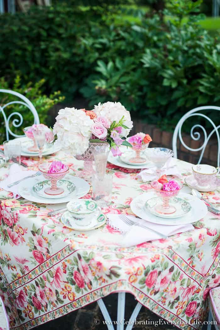 Dining On the Patio, April Cornell tablecloth, April Cornell Rosemary Tablecloth, pink and cream tablescape, stone patio table, Celebrating Everyday Life with Jennifer Carroll