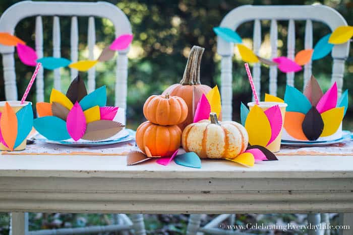 kids thanksgiving table, kids thanksgiving crafts, kids feather headress, kids paper crafts, kids paper feathers, thanksgiving paper decorations, paper feather garland, paper feather decoration, Celebrating Everyday Life with Jennifer Carroll