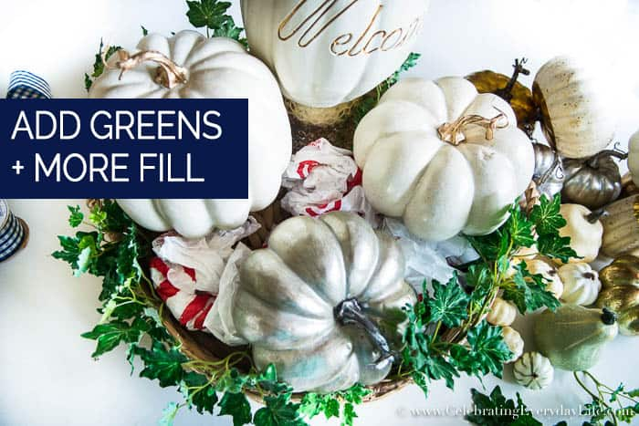 How to Make an Easy White & Gold Fall Table Display Step Three Add Greenery and extra fill