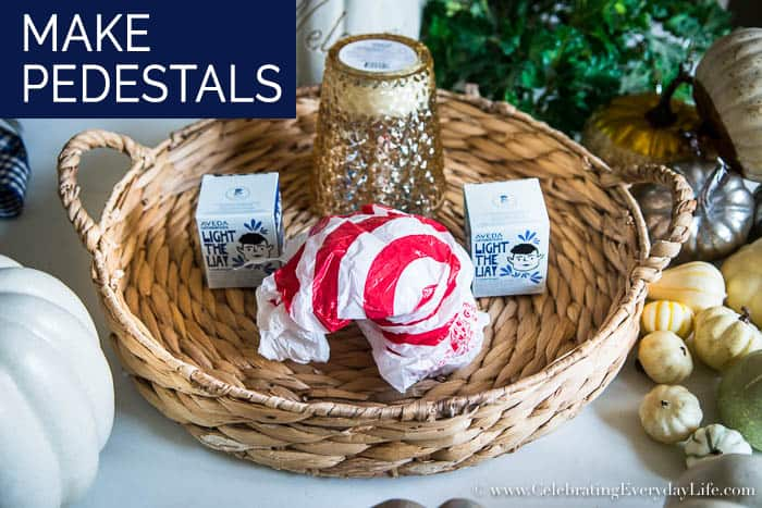 How to Make an Easy White & Gold Fall Table Display Step One Place Pedestals
