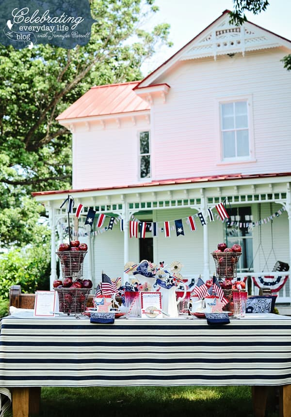 Patriotic Table for 4th of July BBQ or Picnic with red, white & blue decorations, flags & bunting