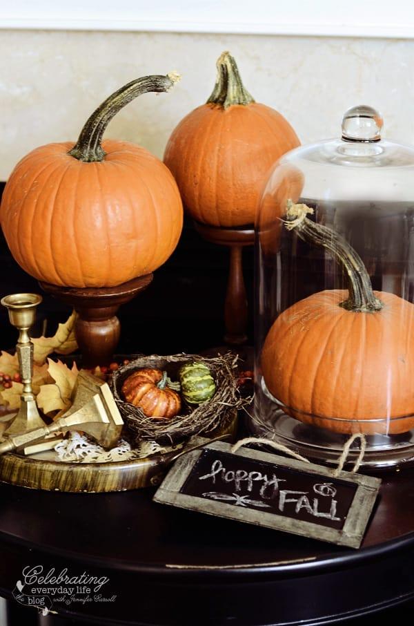 10 Ways to Decorate with Pumpkins - Set on Candlesticks (via Celebrating Everyday Life) | www.andersonandgrant.com