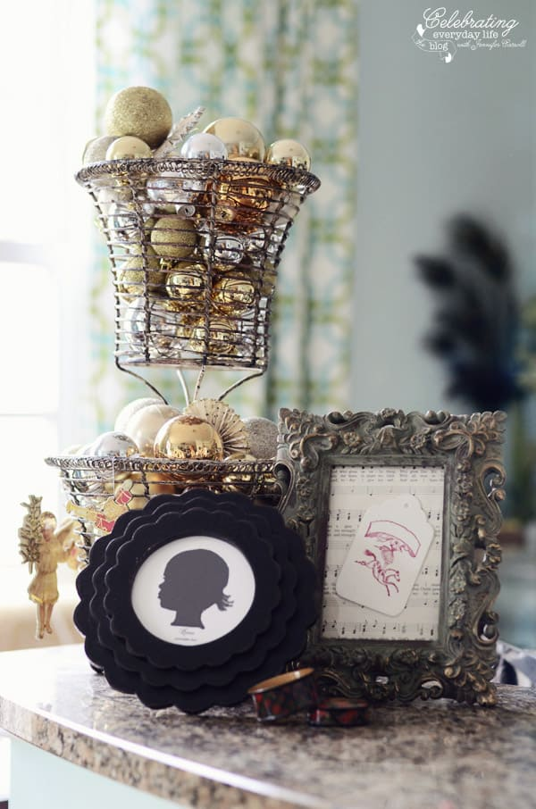 Framed Silhouette, Framed sheet music, and Ornament ball display