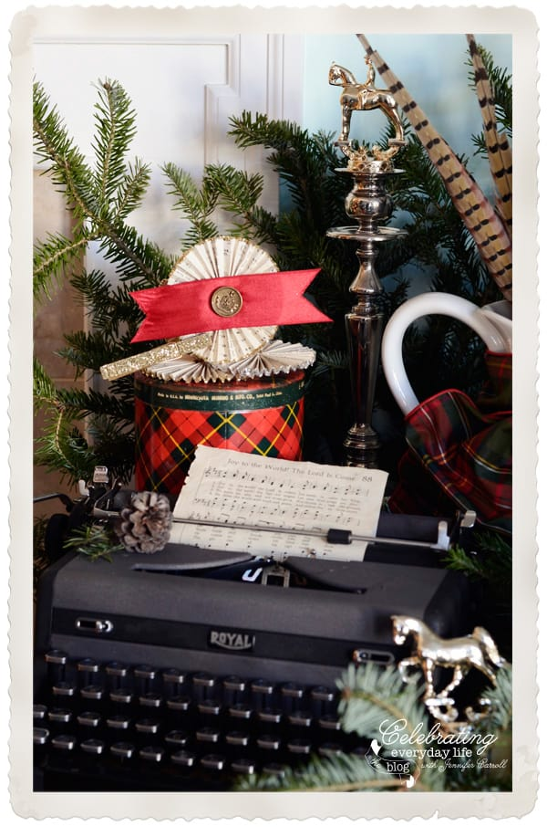 Vintage Typewriter, Joy to the World hymn sheet music, vintage paper medallions, pheasant feathers, horse trophies, plaid Christmas decorations, old fashioned Christmas decorations