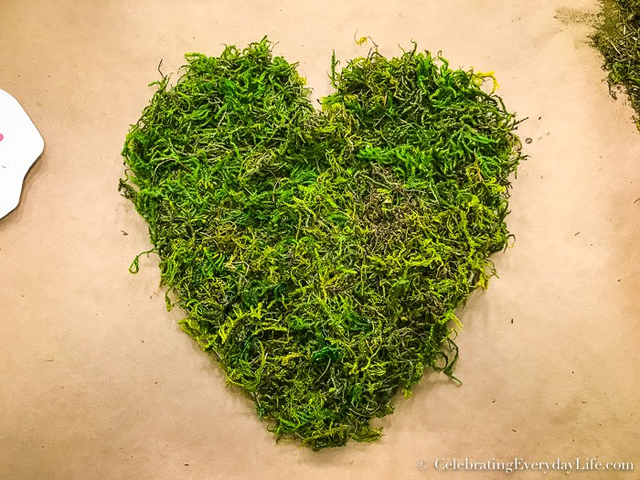 Chipboard heart covered in moss.