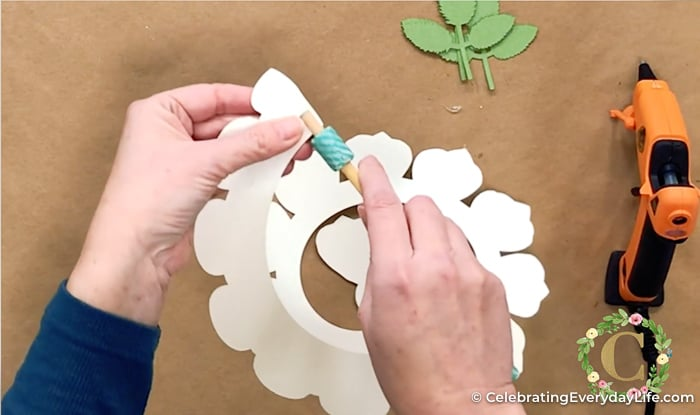 Preparing to roll a paper rose flower with a DIY quilling tool