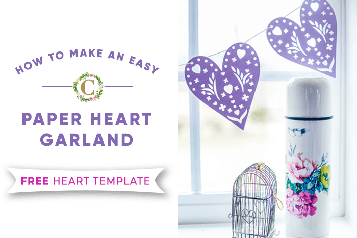 purple cut-out paper heart garland with floral thermos and tiny birdcage
