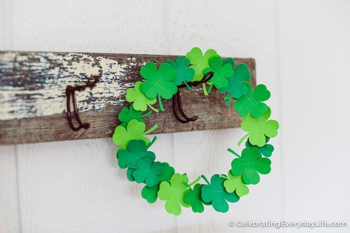 easy paper shamrock wreath on a rustic hook